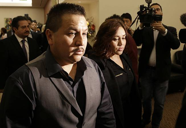 Rodrigo Lopez, left, and Sujay Cruz, parents of Andy Lopez, walk to a news conference in San Francisco, Nov. 4, 2013.
