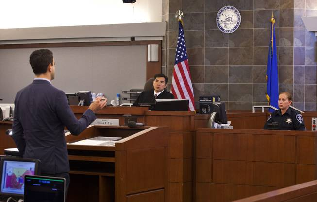 Deputy District Attorney Kenneth Portz addresses the court during the trial for Joey Kadmiri at the Regional Justice Center on  Tuesday, July 8, 2014.