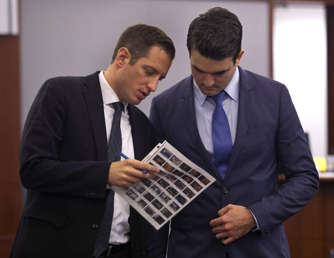 Prosecuting attorneys Jeff Rogan and Kenneth Portz look through evidence information as the Joey Kadmiri trial continues at the Regional Justice Center on  Tuesday, July 8, 2014.