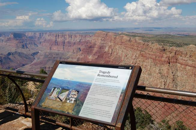 This Sept. 12, 2013, photo released by the National Park Service shows a National Historical Landmark plate overlooking the east end of the Grand Canyon in Arizona where two commercial airplanes crashed on June 30, 1956.