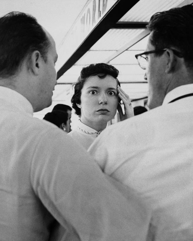 "Mrs. Robert E. Lacy of St. Louis pauses with a look of stunned horror in St. Louis, July 1, 1956 after receiving word that a TWA airliner on which her half sister, Bessie Whitman of San Francisco, was traveling for a visit. The plane's wreckage was found later in the Grand Canyon. Mrs. Lacy and friends were awaiting the plane's arrival at the St. Louis Municipal Airport. ""I feel like I'm going to faint"", she said. Mrs. Lacy was helped to a rear office at the airport before going home."