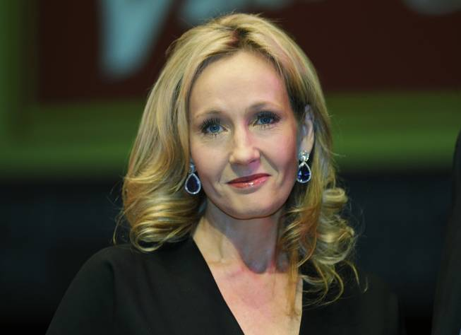 In this Thursday, Sept. 27, 2012, file photo, British author J.K. Rowling poses for photographers at the Southbank Centre in London.