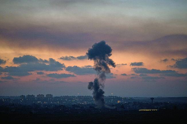 Smoke rises following an Israeli strike on Gaza, as seen from the Israel-Gaza Border, Tuesday, July 8, 2014. The Israeli military launched a major offensive in the Hamas-ruled Gaza Strip on Tuesday, striking more than 100 sites and mobilizing troops for a possible ground invasion.