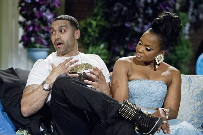 "This 2014 image released by Bravo shows Apollo Nida and his wife Phaedra Parks, cast members of ""The Real Housewives of Atlanta,"" during the taping of a reunion special in Atlanta."