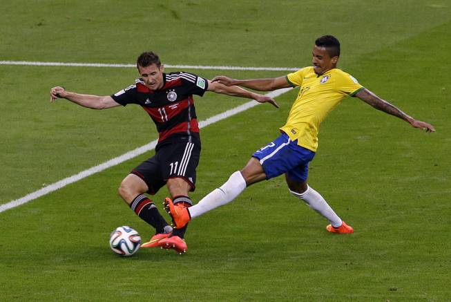 Germany's Miroslav Klose (11) shoots at goal during the World Cup semifinal soccer match between Brazil and Germany at the Mineirao Stadium in Belo Horizonte, Brazil, Tuesday, July 8, 2014.