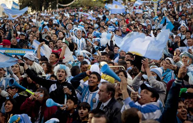 Argentina soccer fans cheer before watching the World Cup semifinal match between Argentina and Netherlands on an outdoor screen set up in Buenos Aires, Argentina, Wednesday, July 9, 2014.