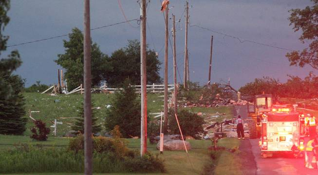 Debris is visible at Goff Road in Smithfield, N.Y., following severe storm on Tuesday, July 8, 2014. Officials in central New York say four people are dead and four homes have been destroyed in building collapses amid severe thunderstorms.