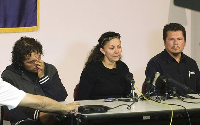 Cousin Gustavo Allende, left, mother Marisol Hernandez, center, and father Pablo Rubio speak to the press about homicide victim Rubi Rubio during a press conference at the Santa Ana Police Department Tuesday, July 8, 2014, in Santa Ana, Calif.