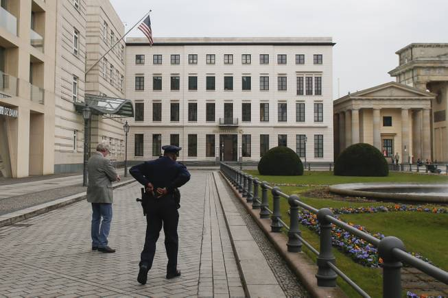 In this April 16, 2013, file photo, United States security officers patrol in front of the U.S. embassy in Berlin, Germany.