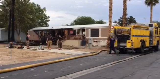 Two people, an adult and a child, suffered minor smoke inhalation when this mobile home at a park in the 800 block of Lamb Boulevard caught fire Thursday, July 10, 2014, Las Vegas Fire & Rescue officials said.