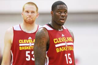 Cleveland center Alex Kirk, left, and forward Anthony Bennett take part in the Cavaliers NBA Summer League game against the Milwaukee Bucks Friday, July 11, 2014 at the Cox Pavilion.