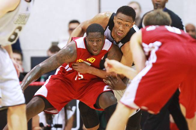 Cleveland forward Anthony Bennett and Milwaukee forward Chris Wright fight for position during their NBA Summer League game Friday, July 11, 2014 at the Cox Pavilion.