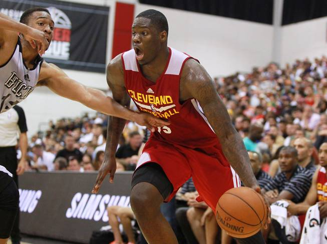 Cleveland forward Anthony Bennett is guarded by Milwaukee forward Jabari Parker during their NBA Summer League game Friday, July 11, 2014 at the Cox Pavilion.