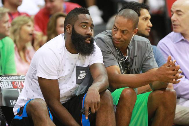 Houston guard James Harden, left, talks with Findlay Prep coach Jerome Williams during the NBA Summer League game between Cleveland and Milwaukee Friday, July 11, 2014 at the Cox Pavilion.