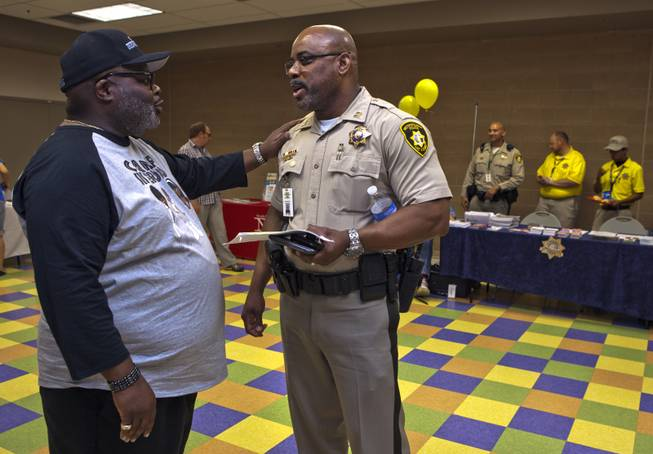 "Melvin ""Beetle"" Ennis chats with longtime friend Capt. Will Scott of the Bolden Area Command on Saturday, June 28, 2014.  They joined many others at a Stop the Violence event at the Pearson Community Center in response to the recent spate of homicides in that area."
