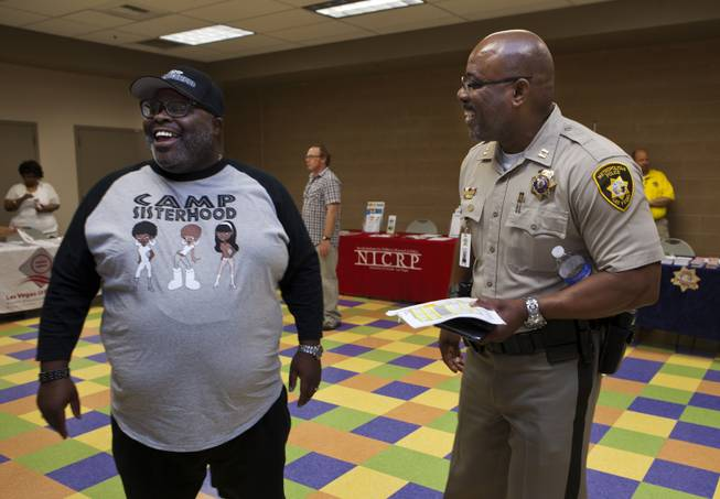 "Melvin ""Beetle"" Ennis jokes with longtime friend Capt. Will Scott of the Bolden Area Command on Saturday, June 28, 2014.  They joined many others at a Stop the Violence event at the Pearson Community Center in response to the recent spate of homicides in that area."