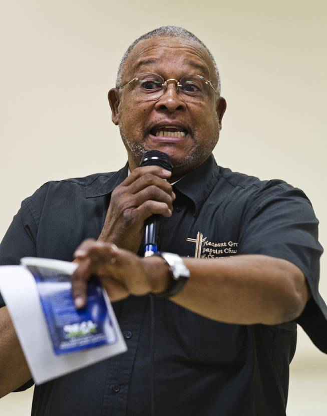 "Pastor Willie Cherry relays some words of empowerment to the audience during a ""Stop the Violence"" event at the Pearson Community Center on Saturday, June 28, 2014."