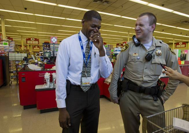 Fred Thomas with Buy Low and Metro Police Officer Gordie Bush share a laugh during a store visit on Thursday, July 3, 2014.  The two are good friends and Thomas is hoping to join the force soon as another way of giving back to his community.