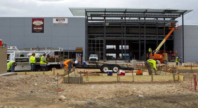 Workers with Martin-Harris Construction continue their tasks as the new Las Vegas Harley-Davidson Motorcycle dealership on the South Strip is under construction on Thursday, July 10, 2014.