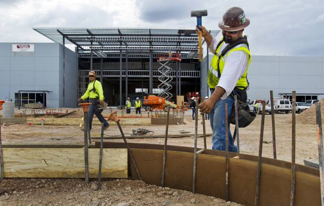 Martin Fierro with Martin-Harris Construction pounds in stakes as the new Las Vegas Harley-Davidson Motorcycle dealership on the South Strip is under construction on Thursday, July 10, 2014.