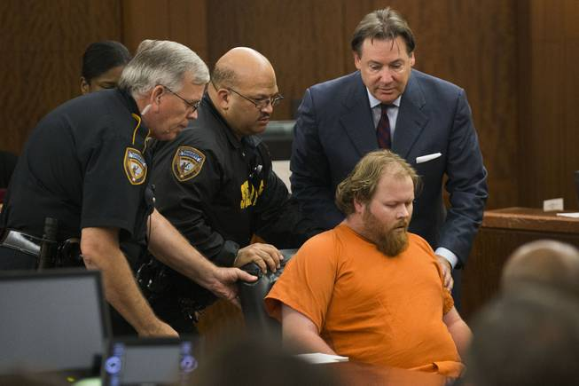 Ronald Lee Haskell collapses as he appears in court on Friday, July 11, 2014, in Houston. Haskell, 33, is accused of killing his ex-wife's sister, Katie Stay, her husband and the children, ranging in age from 4 to 14, after binding and putting them face-down on the floor of their suburban Houston home.