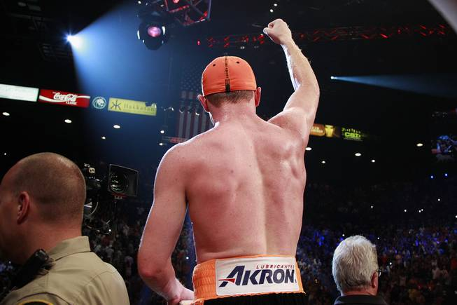 "Saul ""Canelo"" Alvarez salutes the crowd after his 12 round split decision win over Erislandy Lara in their super welterweight fight Saturday, July 12, 2014 at the MGM Grand Garden Arena."