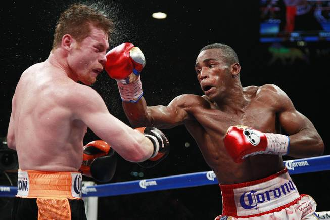 "Saul ""Canelo"" Alvarez is hit by a right from Erislandy Lara during their super welterweight fight Saturday, July 12, 2014 at the MGM Grand Garden Arena. Canelo won a split decision."