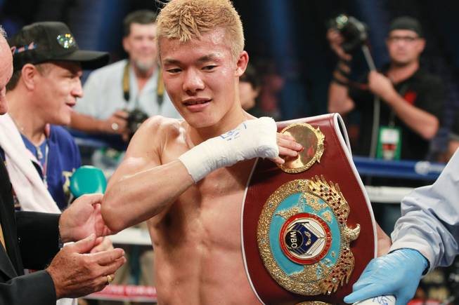 Tomoki Kameda puts his belt on his shoulder after knocking out Pungluang Singyu in the 7th round to retain his WBO bantamweight title Saturday, July 12, 2014 at the MGM Grand Garden Arena.
