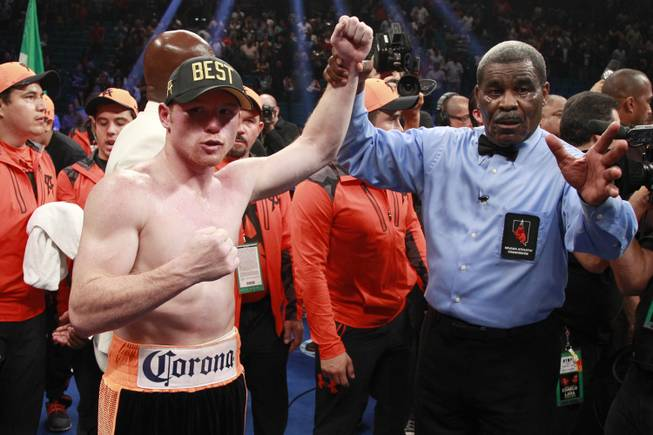 "Saul ""Canelo"" Alvarez waives to the crowd following a super welterweight fight against Erislandy Lara Saturday, July 12, 2014 at the MGM Grand Garden Arena."