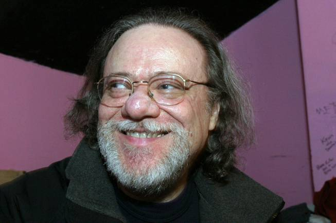 In this Jan. 8, 2005, file photo, Tommy Ramone, ex-drummer and manager of the Ramones, smiles as he is interviewed backstage at the Knitting Factory in New York. A business associate says Ramone, a co-founder of the seminal punk band and the last surviving member of the original group, died Friday, July 11, 2014. Ramone was 65.
