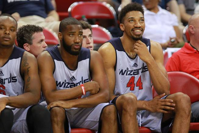 Washinton forward Khem Birch smiles on the bench during their NBA Summer League game against Atlanta Saturday, July 12, 2014 at the Thomas & Mack Center.
