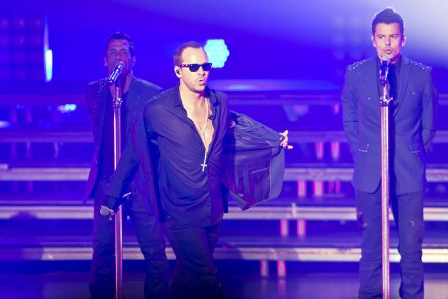Danny Wood, Donnie Wahlberg and Jordan Knight of New Kids on the Block perform in the Axis at Planet Hollywood on Thursday, July 10, 2014.