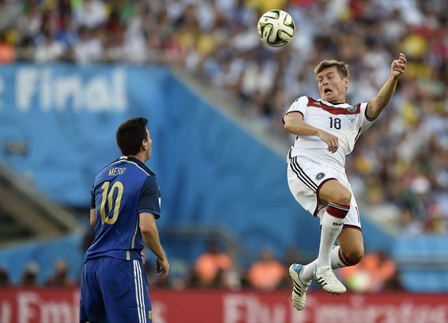 Germany's Toni Kroos (18) rises above Argentina's Lionel Messi (10) to head the ball during the World Cup final soccer match between Germany and Argentina at the Maracana Stadium in Rio de Janeiro, Brazil, Sunday, July 13, 2014.