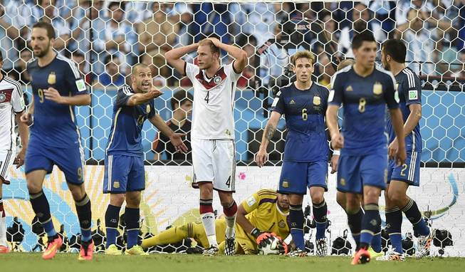 Germany's Benedikt Hoewedes (4) reacts after hitting the post with a header during the World Cup final soccer match between Germany and Argentina at the Maracana Stadium in Rio de Janeiro, Brazil, Sunday, July 13, 2014.