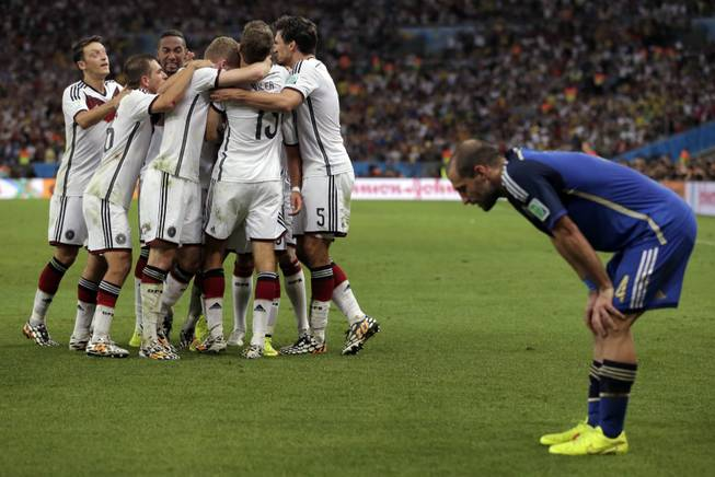 Germany's Mario Gotze (19) celebrates with teammates after scoring his side's first goal in extra time against Argentina's goalkeeper Sergio Romero during the World Cup final soccer match between Germany and Argentina at the Maracana Stadium in Rio de Janeiro, Brazil, Sunday, July 13, 2014.