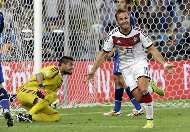 Germany's Mario Gotze celebrates after scoring the opening goal during the World Cup final soccer match between Germany and Argentina at the Maracana Stadium in Rio de Janeiro, Brazil, Sunday, July 13, 2014. Germany won 1-0 to win the World Cup.