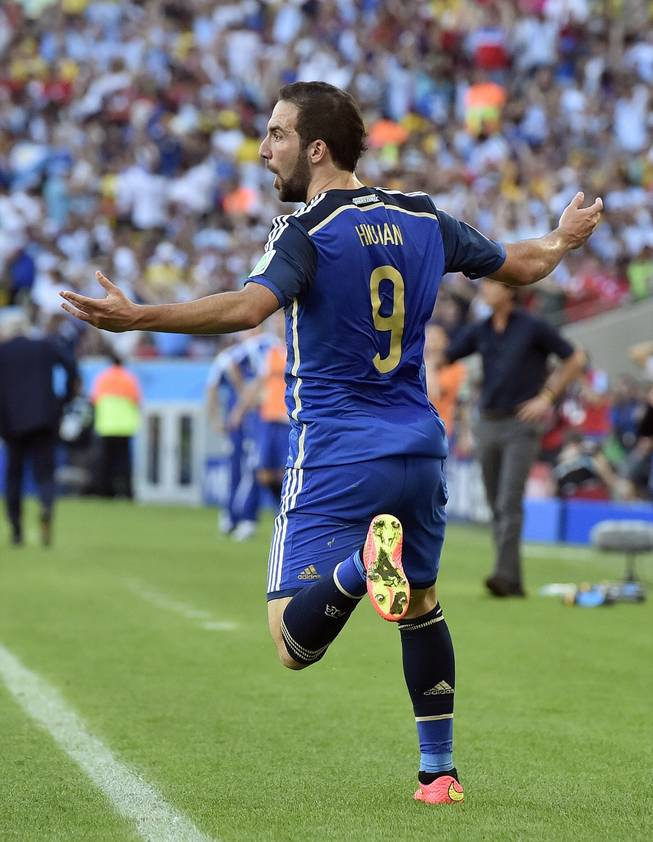 Argentina's Gonzalo Higuain reacts to an official's call after the goal he scored was disallowed during the World Cup final soccer match between Germany and Argentina at the Maracana Stadium in Rio de Janeiro, Brazil, Sunday, July 13, 2014.