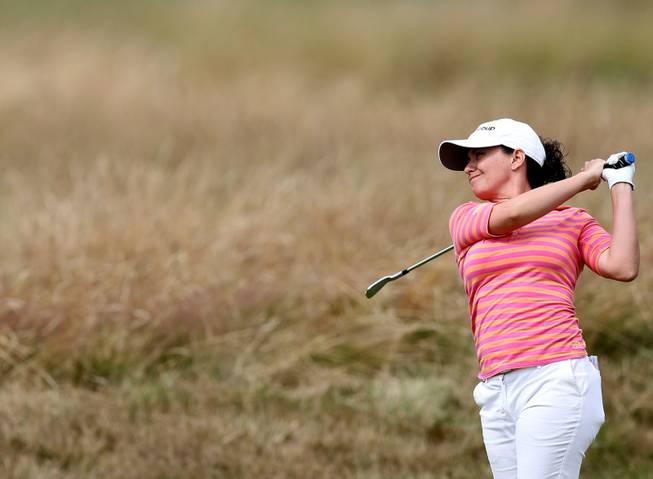 Mo Martin of the U.S. plays a shot on the 11th fairway during the third day of the Women's British Open golf championship at the Royal Birkdale Golf Club, in Southport, England, Saturday, July 12, 2014. She hit an eagle in the final day of play Sunday to win.
