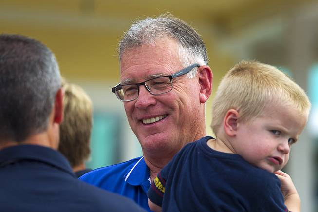 Henderson Mayor Andy Hafen holds his grandson Isaac Stewart, 2, before an official opening ceremony for the Cowbunga Bay water park in Henderson Monday, July 14, 2014. The new water park opened on July 4. STEVE MARCUS
