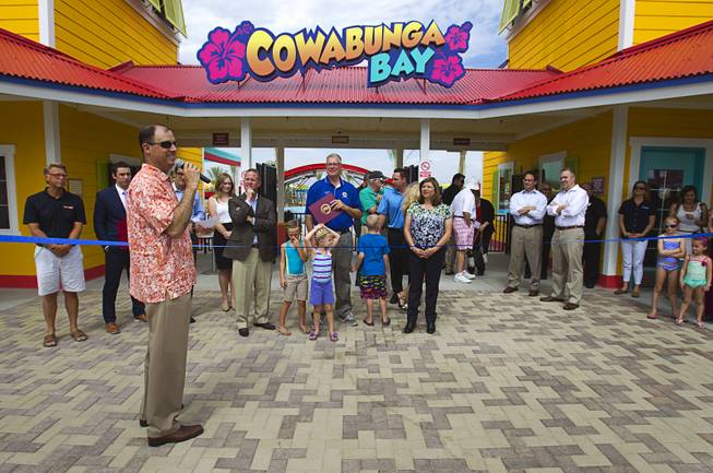 Scott Muelrath, left, president and CEO of the Henderson Chamber of Commerce, speaks during an official opening ceremony for the Cowbunga Bay water park in Henderson Monday, July 14, 2014. The new water park opened on July 4. STEVE MARCUS