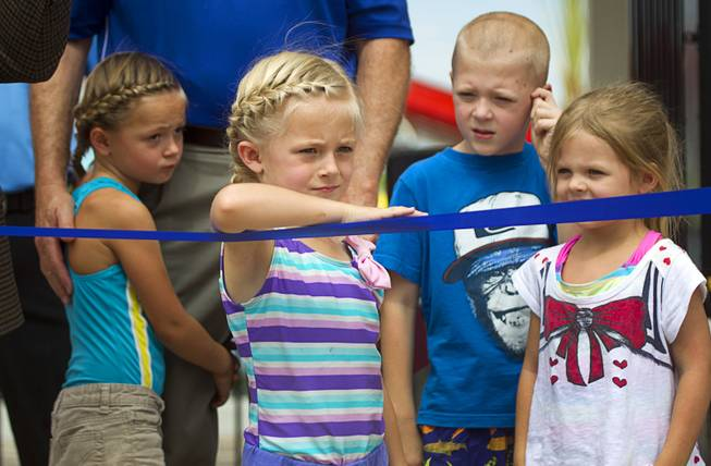 Amber Stewart, center, 5, and other grandchildren of Henderson Mayor Any Hafen, wait for an official opening ceremony for the Cowbunga Bay water park in Henderson Monday, July 14, 2014. The new water park opened on July 4. STEVE MARCUS