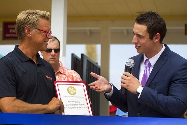 Stephen Sifuentes, right, representing Sen. Dean Heller, presents a certificate to Shane Huish, general manager of the Cowbunga Bay water park, during an official opening ceremony for the water park in Henderson Monday, July 14, 2014. The park opened on July 4. STEVE MARCUS