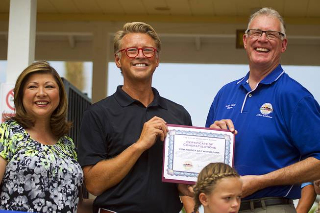 Shane Huish, general manager of the Cowbunga Bay water park, poses with Henderson City Councilwoman Gerri Schroder, left, and Henderson Mayor Andy Hafen during an official opening ceremony for the water park in Henderson Monday, July 14, 2014. The park opened on July 4. STEVE MARCUS