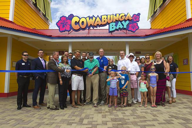 Orluff Opheikens, center, chairman of the board for R&O Construction, politicians and invited guests cut a ribbon during an official opening ceremony for the Cowbunga Bay water park in Henderson Monday, July 14, 2014. The new water park opened on July 4. STEVE MARCUS