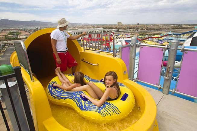 Lifeguard Jesus Sanchez holds up riders until the ride is clear at the Cowbunga Bay water park in Henderson Monday, July 14, 2014. The new water park opened on July 4. STEVE MARCUS