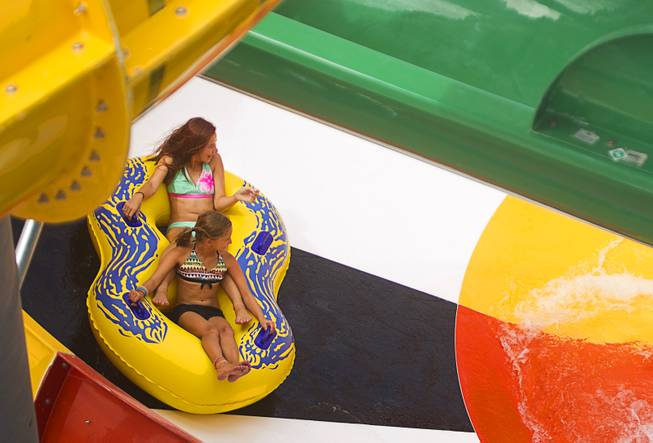 Girls take a ride at the Cowbunga Bay water park in Henderson Monday, July 14, 2014. The new water park opened on July 4. STEVE MARCUS