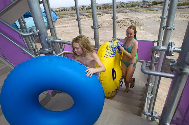 Riders climb stairs to a ride at the Cowbunga Bay water park in Henderson Monday, July 14, 2014. The new water park opened on July 4. STEVE MARCUS