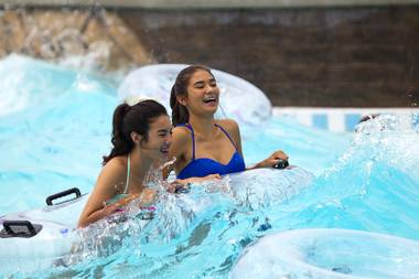 Teens enjoy a wave pool at the Cowbunga Bay water park in Henderson Monday, July 14, 2014. The new water park opened on July 4. STEVE MARCUS