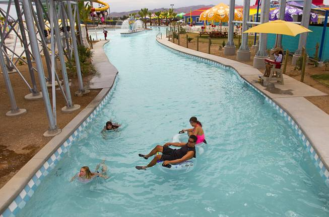 People float on a lazy river at the Cowbunga Bay water park in Henderson Monday, July 14, 2014. The new water park opened on July 4. STEVE MARCUS