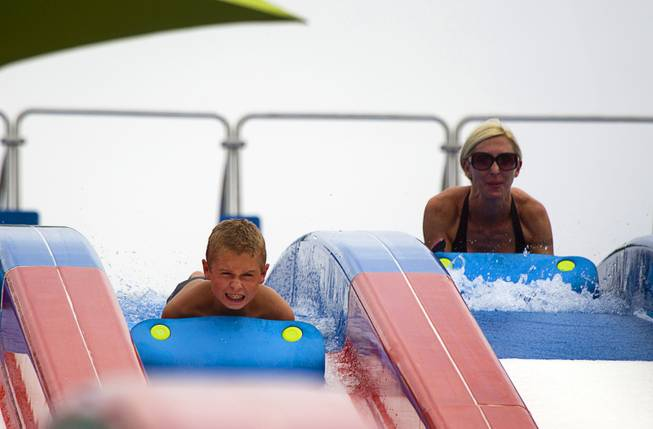 A boy heads down a slide at the Cowbunga Bay water park in Henderson Monday, July 14, 2014. The new water park opened on July 4. STEVE MARCUS